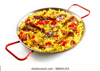 Isolated single pan full of spare ribs and Spanish rice garnished with red bell pepper slices in pan