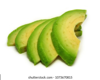Isolated sliced avocado pieces