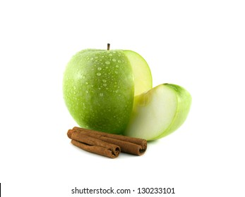 Isolated sliced green apple with slice and cinnamon (white background). Fresh diet fruit (water drops). Healthy fruit with vitamins.