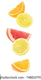 Isolated slices of citrus fruits. Falling pieces of orange, lemon and grapefruit isolated on white background with clipping path