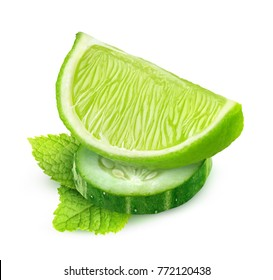 Isolated slices of cucumber and lime, and mint leaf (cocktails component) isolated on white background, with clipping path