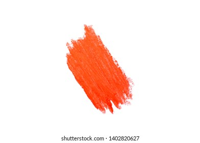 Isolated smear of lipstick in a trendy coral color.
