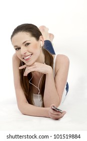 Isolated smiling young girl listening to music