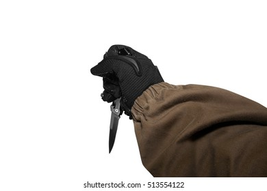 Isolated soldier arm holding knife. Isolated first person view soldier hand in black battle gloves & tactical jacket holding knife ready to attack in upper position.