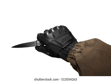 Isolated soldier arm holding tactical knife. Isolated first person view soldier hand in black battle gloves & tactical jacket holding knife ready for defense.