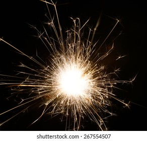 an isolated spark from a sparkler