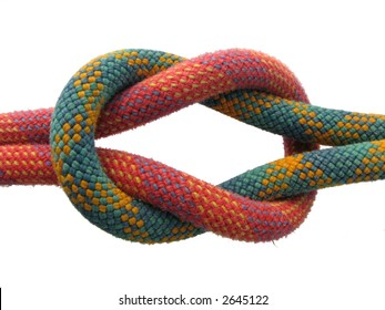 isolated square knot with red and green climbing ropes