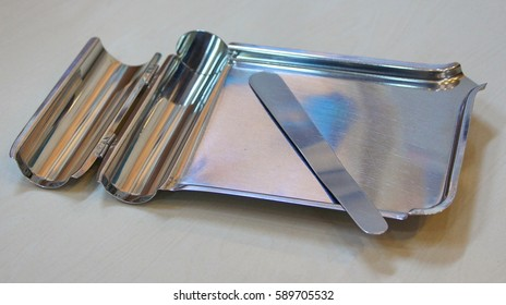 Isolated stainless tray for Phamacy. Prepare medicine. Counting medicine on stainless tray.