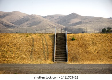 Isolated stairs up river levee with mountains in background