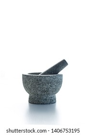 Isolated stony mortar and pestle, grinding and mixing tool with white background