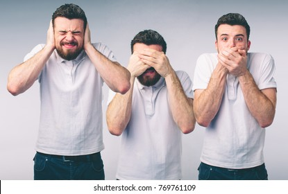 Isolated studio shot of a Caucasian woman in the See No Evil, Hear No Evil, Speak No Evil poses.
