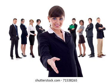 Isolated successful business team, focus on woman with handshake gesture.