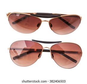 Isolated sun glasses on white background, top view, unisex (male and female glasses)