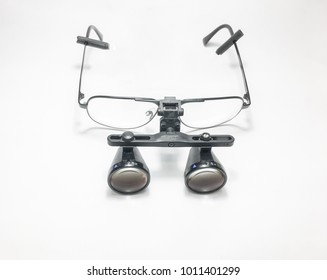isolated of surgeon glasses with lens loupes.