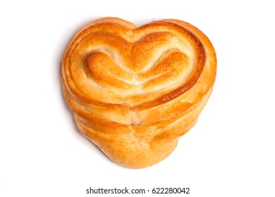 Isolated sweet rolls, bread heart shaped bread with filling on white background