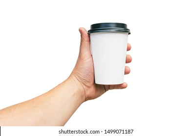 Isolated Takeaway cup, for Coffee, Tea in a guy s hand with a black cap, on a white background. Takeaway food concept.