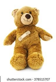 Isolated teddy bear with band aid.