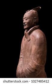Isolated Terracotta Warrior against a plain black backdrop