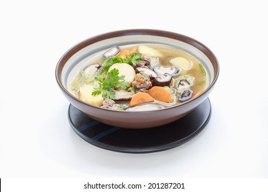 Isolated of Thai and Asian style mushroom soup are mildly seasoned soup that Consisting of pork, tofu, carrots, Chinese Cabbage and mushrooms. good for children and the sick, White background