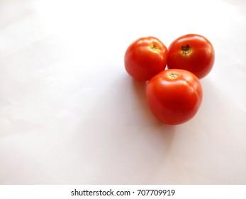 Isolated Three Tomatoes