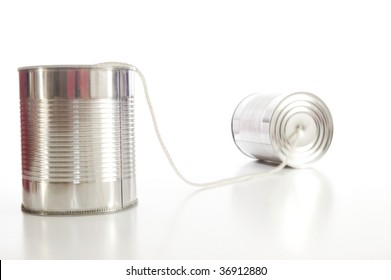 isolated tin or can telephone showing communication