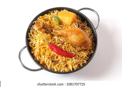 Isolated Top view of Bombay biryani, Traditional spicy indian food, Iftar meal, Chicken rice Ramadan dinner on white background.