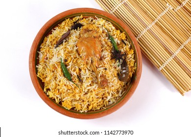 Isolated Top view of Bombay biryani, Traditional spicy indian food, Iftar meal, Chicken rice Ramadan dinner on white background, Diwali or christmas party.