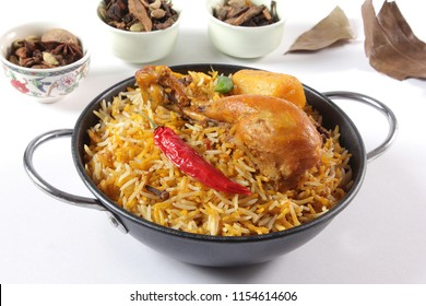 Isolated top view of chicken biryani, Traditional indian food, Pakistani popular lunch, Ramzan iftar dinner, Ramadan meal.