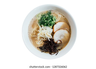 Isolated Top view of Hakata style Shio Chashumen (Salt soup) including noodle, sliced barbecued pork, sprout, seaweed and scallion.