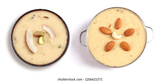 Isolated top view of kheer with almond and coconut topping, Beautiful dessert bowl on white background, Eid dinner meal, Christmas sweet dish.