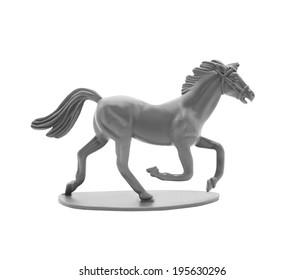 Isolated toy horse figurine.