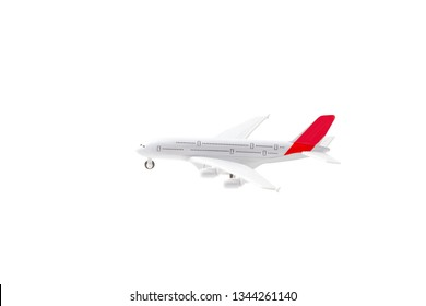 Isolated toy model of an airplane. Travel and air transport concept