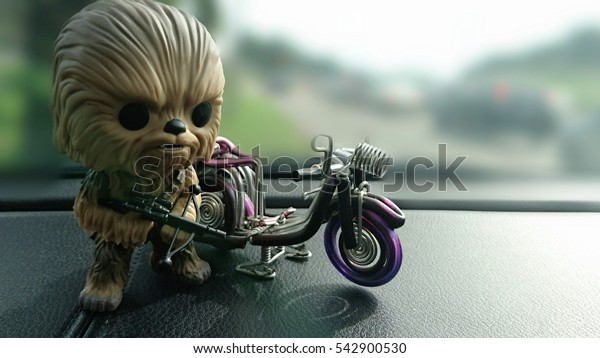 isolated toys chewbacca and motorbike in blurry background