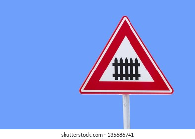 isolated traffic sign approaching a railroad secured with automatic gate