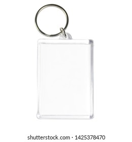 Isolated transparent empty acrylic keychain (blank template) with metallic keyring. White background.