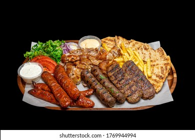 Isolated / Transparent Greek / Arabic Restaurant Grilled Meat Platter, Lamb, Beef, Chicken, Pork Kebab Skewers Sauce Tahini Feta Fries Chips Salad Sausages
