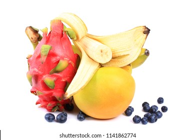 Isolated tropical fruits. , banana, dragon fruit and mango isolated on white background with clipping path. Top view.