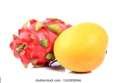 Isolated tropical fruits. ,   dragon fruit and mango isolated on white background with clipping path. Top view.