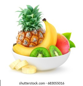 Isolated tropical fruits. Pineapple, banana, kiwi and mango in ceramic bowl isolated on white background with clipping path