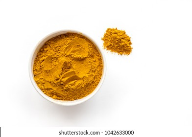 Isolated turmeric powder. White background. Top view.