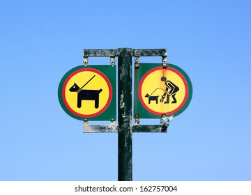 isolated twin sign with pet restrictions on entrance to beach