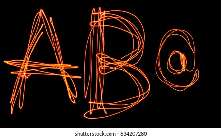 isolated uppercase letter a b and at symbol made of red laser beam