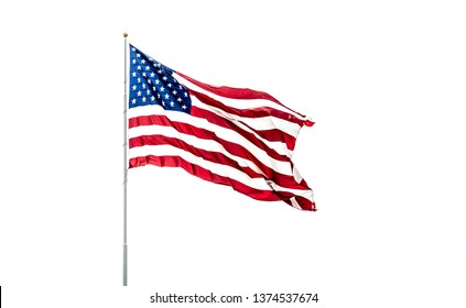 Isolated USA Flag with stars and stripes waving in wind on flag pole against white background.