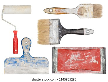 Isolated used painting tools. Paint brushes, roller and spatula.