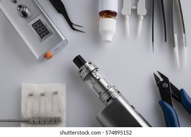 Isolated vaping accessories and tools for mod devices on a white background. Electronic cigarette and Ecig smoking equipment.