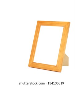 isolated varnished wooden picture frame with stand