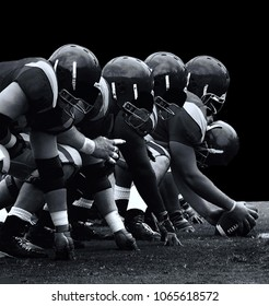 Isolated version of the forward line in American football on Black Teamwork concept