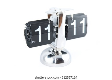 Isolated vintage style flip clock on white background at 11:11