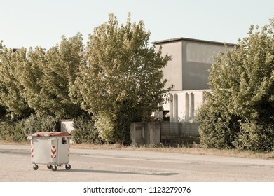 Isolated waste bin on the road (Pesaro, Italy)