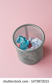 isolated wastebasket full of color waste paper, Recycle bin